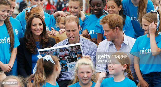 Prince William Duke of Cambridge Catherine Duchess of Cambridge and Prince Harry during a visit to the Commonwealth Games Village on July 29 2014 in...