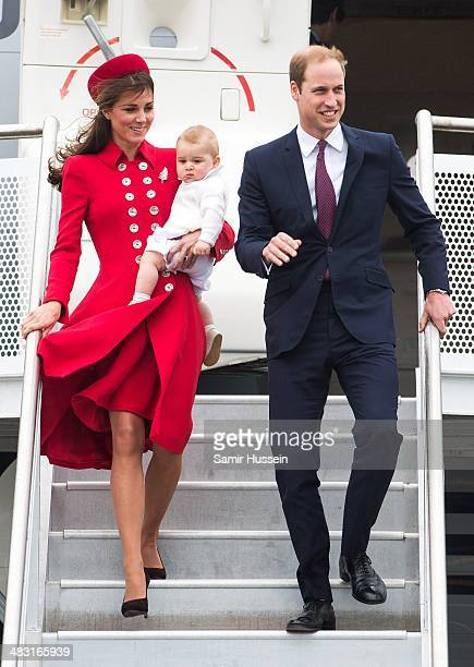 Prince William, Duke of Cambridge, Catherine, Duchess of Cambridge and Prince George of Cambridge arrive at Wellington Airport's military terminal...