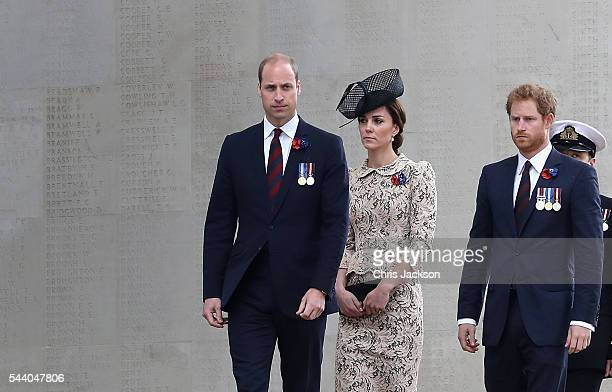 Prince William, Duke of Cambridge, Catherine, Duchess of Cambridge and Prince Harry walk past names of the missing on Thiepval Memorial during Somme...