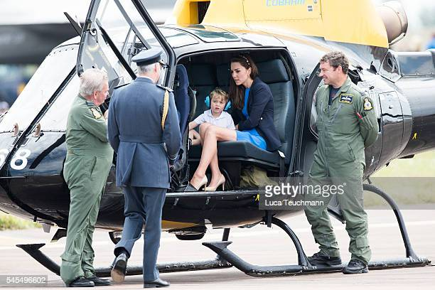 Prince William, Duke of Cambridge, Catherine, Duchess of Cambridge and Prince George sit inside a Squirrel helicopter during a visit to the Royal...