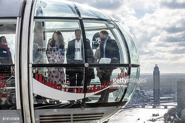 Prince William Duke of Cambridge Catherine Duchess of Cambridge and Prince Harry take a ride in a pod of the London Eye with members of the mental...