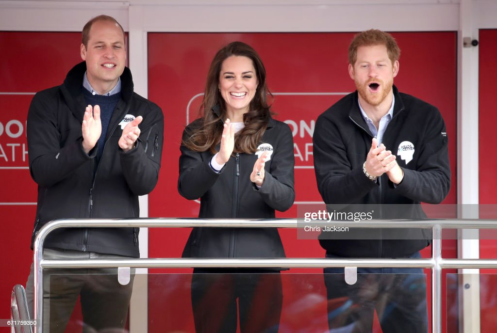Prince William, Duke of Cambridge, Catherine, Duchess of Cambridge and Prince Harry cheer on runners as they signal the start of the 2017 Virgin Money London Marathon on April 23, 2017 in London, England.