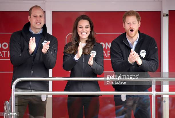 Prince William Duke of Cambridge Catherine Duchess of Cambridge and Prince Harry cheer on runners as they signal the start of the 2017 Virgin Money...