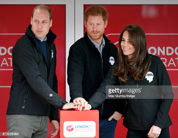 Prince William Duke of Cambridge Catherine Duchess of Cambridge and Prince Harry cheer on runners as they start the 2017 Virgin Money London Marathon...