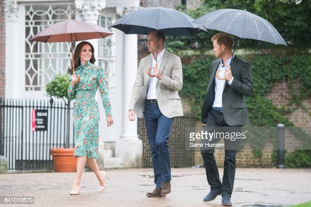 Prince William, Duke of Cambridge, Catherine, Duchess of Cambridge and Prince Harry visit The Sunken Garden at Kensington Palace on August 30, 2017...