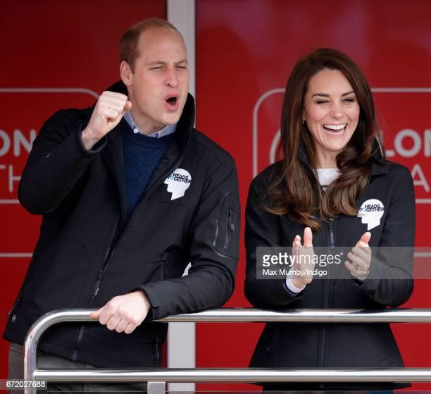 Prince William Duke of Cambridge Catherine Duchess of Cambridge cheer on runners as they start the 2017 Virgin Money London Marathon on April 23 2017...
