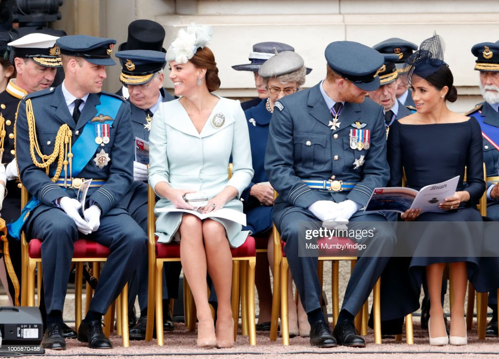 Prince William, Duke of Cambridge, Catherine, Duchess of Cambridge, Prince Harry, Duke of Sussex and Meghan, Duchess of Sussex attend a ceremony to mark the centenary of the Royal Air Force on the forecourt of Buckingham Palace on July 10, 2018 in London, England. The 100th birthday of the RAF, which was founded on on 1 April 1918, was marked with a centenary parade with the presentation of a new Queen's Colour and flypast of 100 aircraft over Buckingham Palace.