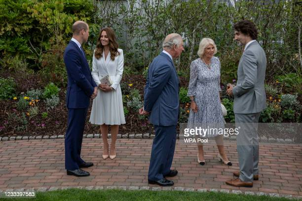 Prince William, Duke of Cambridge, Catherine, Duchess of Cambridge, Camilla, Duchess of Cornwall and Prince Charles, Prince of Wales chat with...