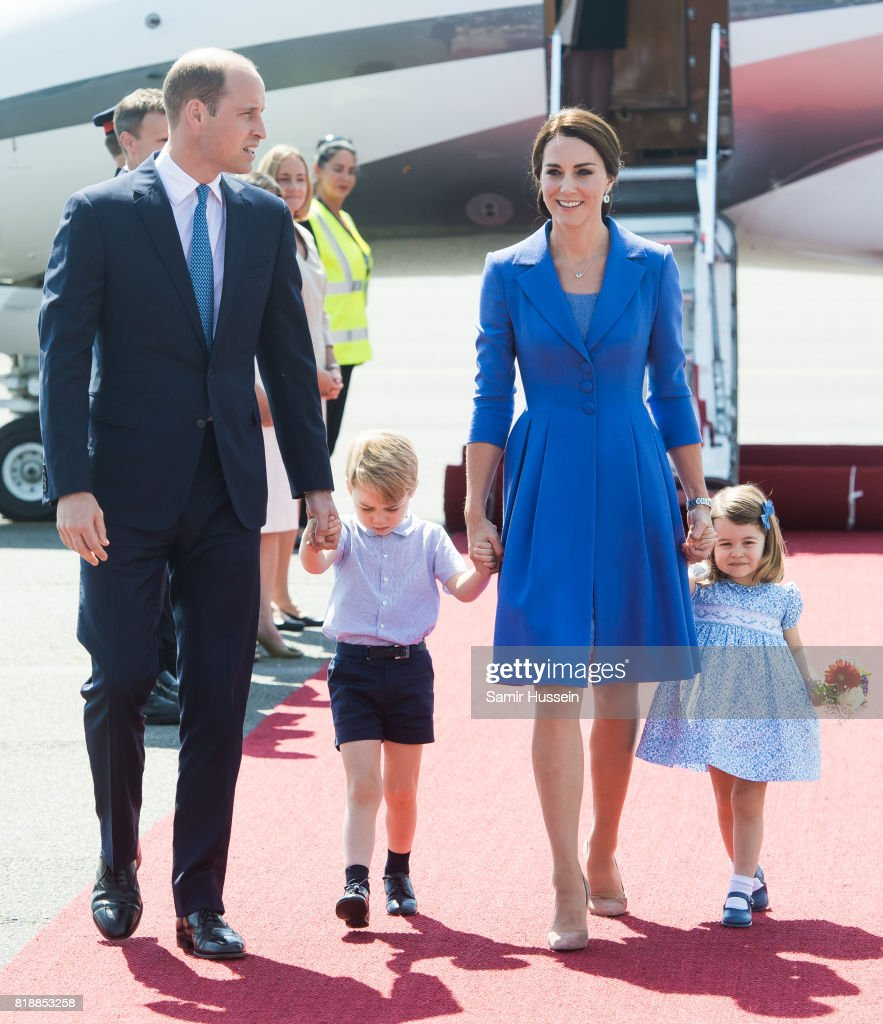 Prince William, Duke of Cambridge, Catherine, Duchess of Cambridge, Prince George of Cambridge and Princess Charlotte of Cambridge arrive at Berlin military airport during an official visit to Poland and Germany on July 19, 2017 in Berlin, Germany.