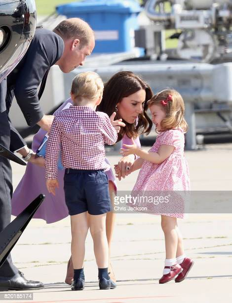 Prince William Duke of Cambridge Catherine Duchess of Cambridge Prince George of Cambridge and Princess Charlotte of Cambridge view helicopter models...