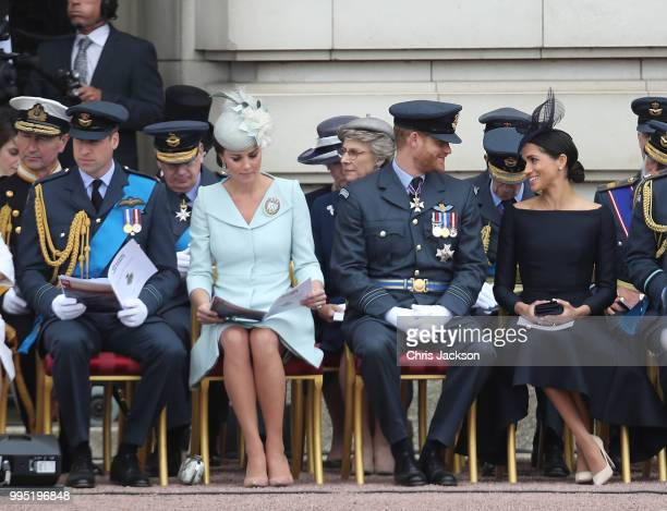 Prince William Duke of Cambridge Catherine Duchess of Cambridge Prince Harry Duke of Sussex and Meghan Duchess of Sussex during the RAF 100 ceremony...