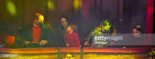 Prince William, Duke of Cambridge, Catherine, Duchess of Cambridge, Prince Louis, Princess Charlotte and Prince George attend a special pantomime...