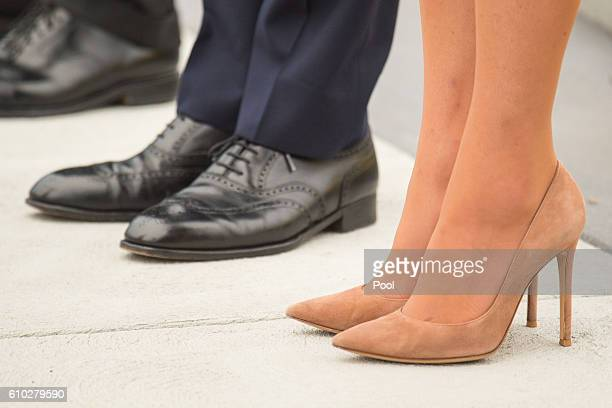 Prince William Duke of Cambridge Catherine Duchess of Cambridge shoe detail attend an official welcome ceremony at the Legislative Assembly of...