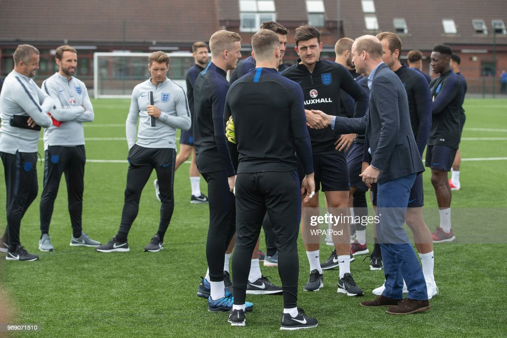 Prince William, Duke of Cambridge chats to England players as he attends the Facility at the FA Training Ground to meet members of the England Squad before their match at Elland Road this Evening on June 7, 2018 in Leeds, England.