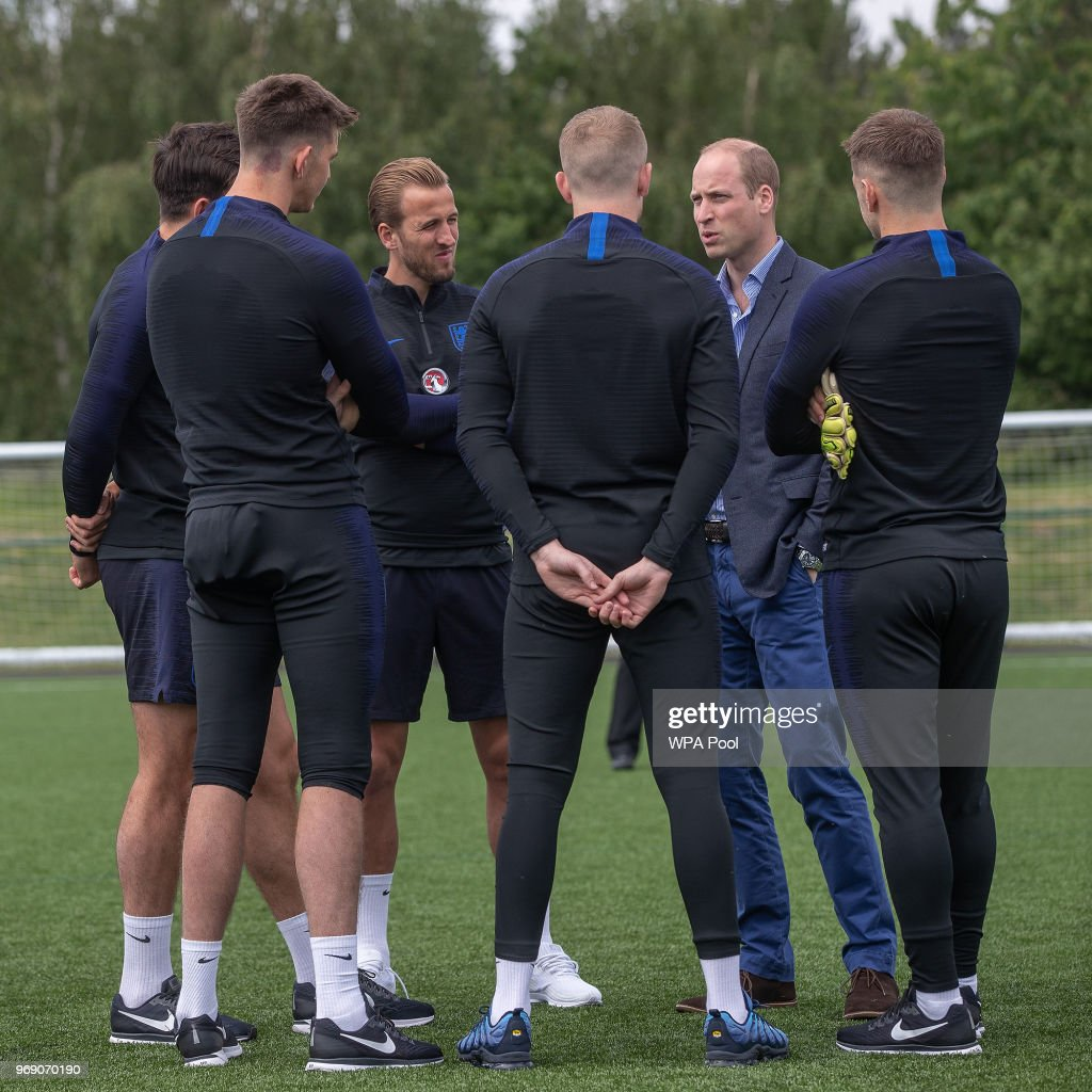 Prince William, Duke of Cambridge chats to England players including Captain Harry Kane (3rd L) as he attends the Facility at the FA Training Ground to meet members of the England Squad before their match at Elland Road this Evening on June 7, 2018 in Leeds, England.