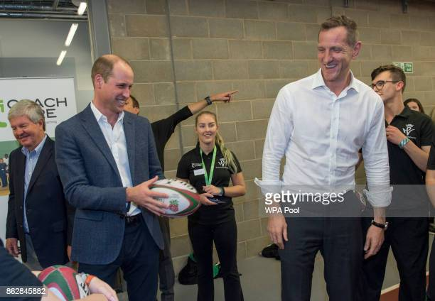 Prince William Duke of Cambridge chats with Former England and British and Irish Lions centre Will Greenwood during the Coach Core graduation...