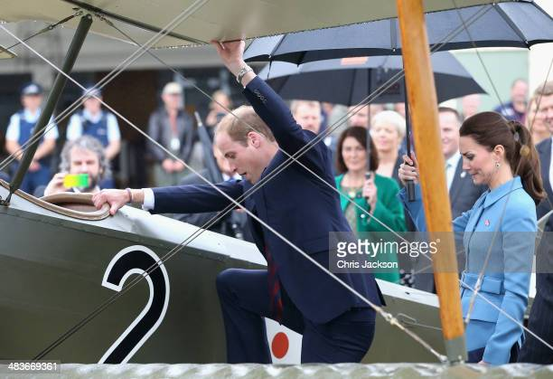 Prince William Duke of Cambridge climbs in to the cockpit of a WWI biplane as Catherine Duchess of Cambridge looks on during a visit to Omaka...
