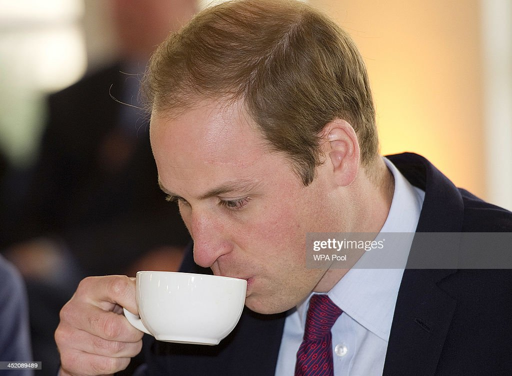 Prince William, Duke of Cambridge drinks a cup of tea as he attends a meeting of 'United for Wildlife' at the Zoological Society of London on November 26, 2013 in London, England. The Duke of Cambridge is President of United for Wildlife, a collaboration of seven of the largest global Conservation organisations.