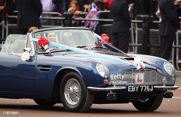 Prince William Duke of Cambridge drives his wife HRH Catherine Duchess of Cambridge in a blue Aston Martin as they leave Buckingham Palace to...