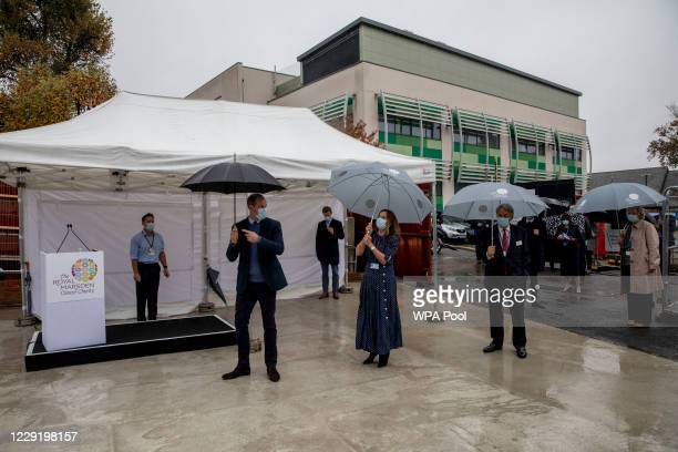 Prince William Duke of Cambridge gestures as attends the marking of the construction of the groundbreaking Oak cancer centre at Royal Marsden...