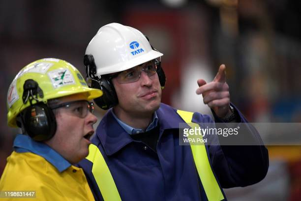 Prince William Duke of Cambridge gestures next to Works Manager Carl Banfield during a visit to Tata Steel on February 04 2020 in Port Talbot Wales