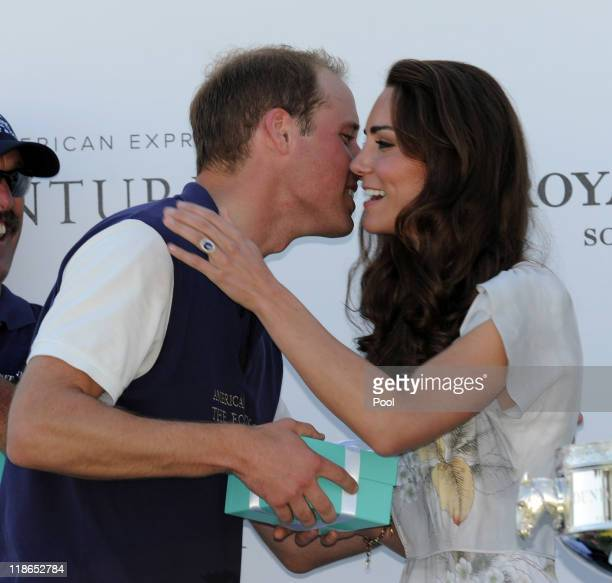 Prince William Duke of Cambridge gets a kiss from Catherine Duchess of Cambridge after Prince William's team won their round robin tournament at the...