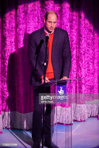 Prince William, Duke of Cambridge gives a speech on stage as he attends a special pantomime performance at London's Palladium Theatre, hosted by The...