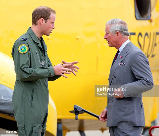 Prince William Duke of Cambridge gives his father Prince Charles Prince of Wales a tour of an RAF Search and Rescue Sea King Helicopter at RAF Valley...