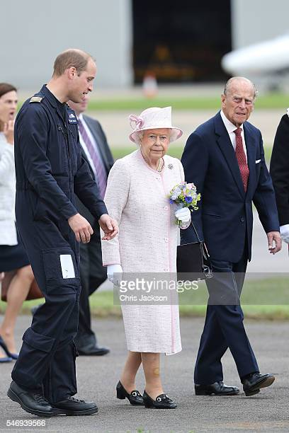 Prince William Duke of Cambridge gives Queen Elizabeth II and Prince Philip Duke of Edinburgh a tour as they open the new East Anglian Air Ambulance...