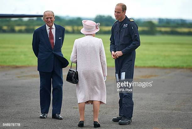 Prince William Duke of Cambridge gives Queen Elizabeth II and Prince Philip Duke of Edinburgh a tour as she opens the new East Anglian Air Ambulance...