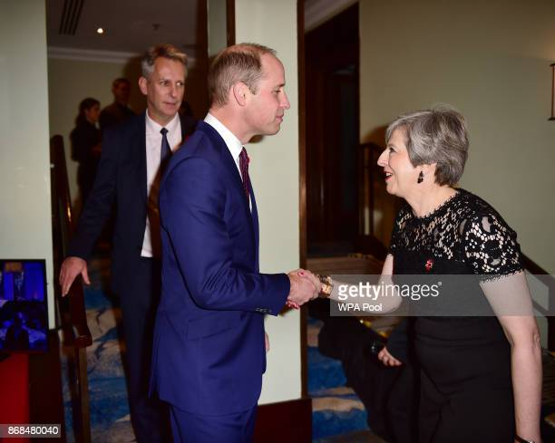 Prince William Duke of Cambridge greets British Prime Minister Theresa May as he attends the Pride Of Britain Awards at the Grosvenor House on...