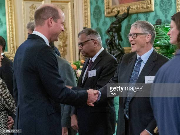 Prince William, Duke of Cambridge greets Microsoft co-founder turned philanthropist Bill Gates during a reception for international business and...