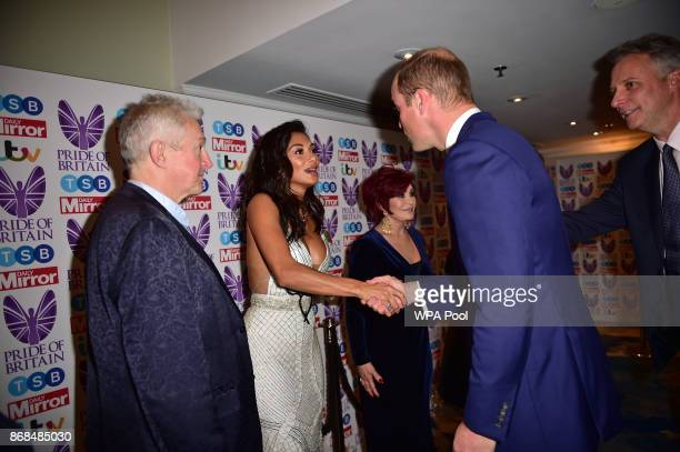 Prince William Duke of Cambridge greets Nicole Scherzinger as he attends the Pride Of Britain Awards at the Grosvenor House on October 30 2017 in...
