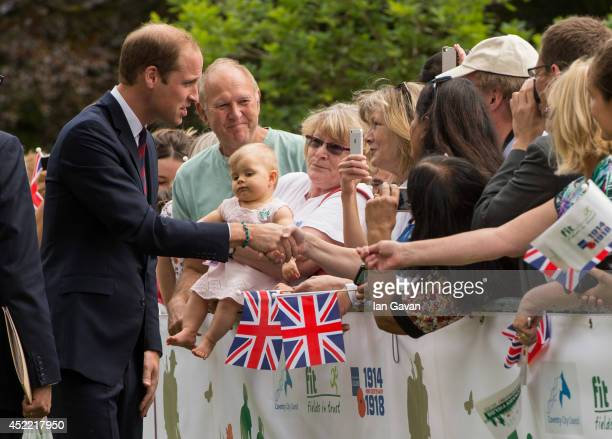 Prince William Duke of Cambridge greets the crowd during an official visit to the Coventry War Memorial Park on July 16 2014 in Coventry England The...