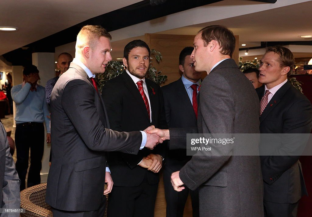 Prince William, Duke of Cambridge (2nd R) greets WRU U'18s player Tom Phillips WRU U18s in the International Player's Lounge after the Autumn International between Wales and South Africa at the Millennium Stadium on November 9, 2013 in Cardiff, Wales.