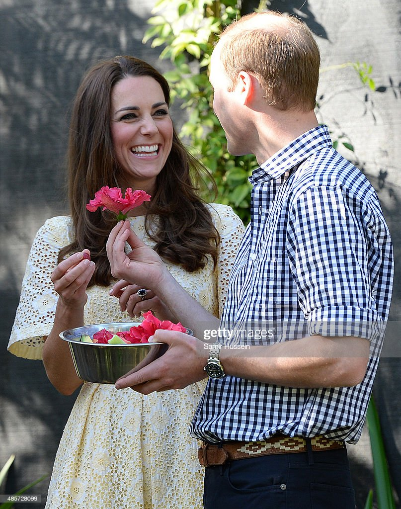 Prince William, Duke of Cambridge hands Catherine, Duchess of Cambridge a flower as they visit the Bilby Enclosure at Taronga Zoo on April 20, 2014 in Sydney, Australia. The Duke and Duchess of Cambridge are on a three-week tour of Australia and New Zealand, the first official trip overseas with their son, Prince George of Cambridge.