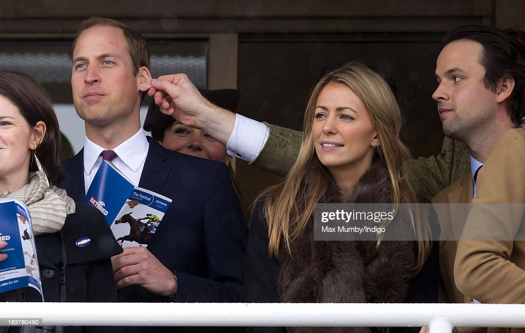 Prince William, Duke of Cambridge has his ear pulled by a friend as he watches the racing on Day 4 of The Cheltenham Festival at Cheltenham Racecourse on March 15, 2013 in London, England.