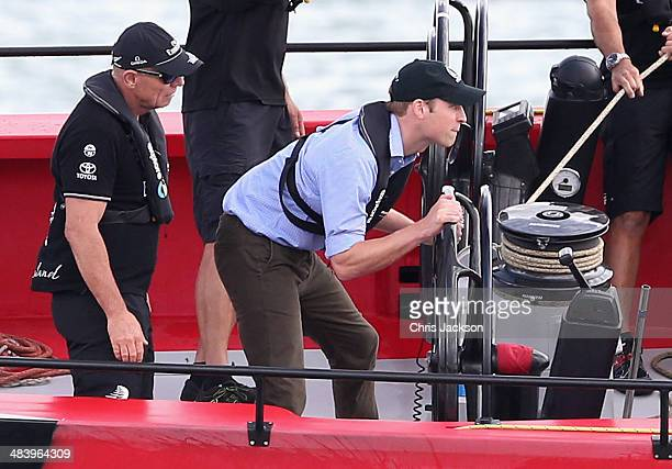 Prince William Duke of Cambridge helms an America's Cup yacht as he races Catherine Duchess of Cambridge in Auckland Harbour on April 11 2014 in...