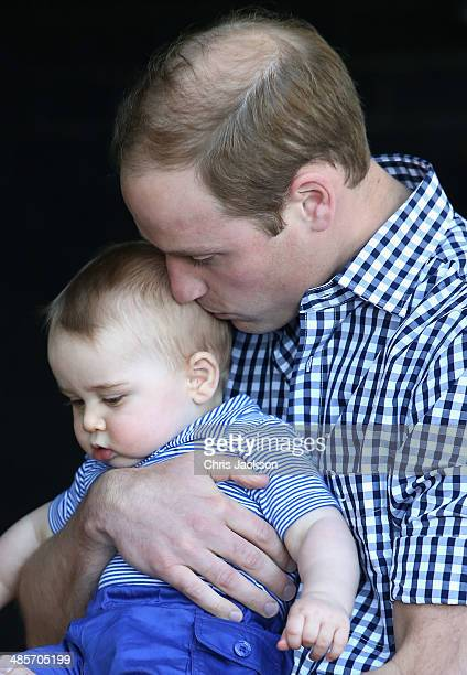 Prince William, Duke of Cambridge holds Prince George of Cambridge as they look at a Bilby called George at Taronga Zoo on April 20, 2014 in Sydney,...