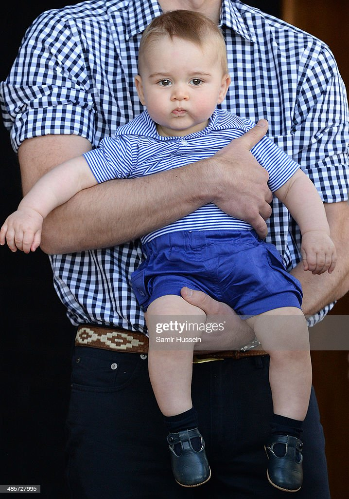Prince William, Duke of Cambridge holds Prince George of Cambridge as they visit the Bilby Enclosure at Taronga Zoo on April 20, 2014 in Sydney, Australia. The Duke and Duchess of Cambridge are on a three-week tour of Australia and New Zealand, the first official trip overseas with their son, Prince George of Cambridge.