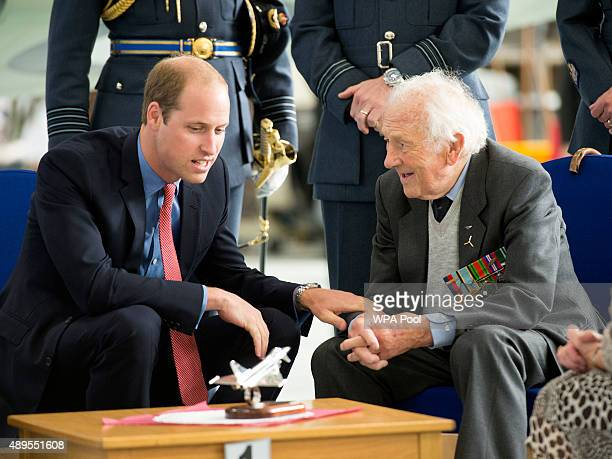 Prince William Duke of Cambridge Honorary Air Commandant of Royal Air Force Coningsby chats to Battle of Britain Spitfire pilot Squardon Leader Tony...