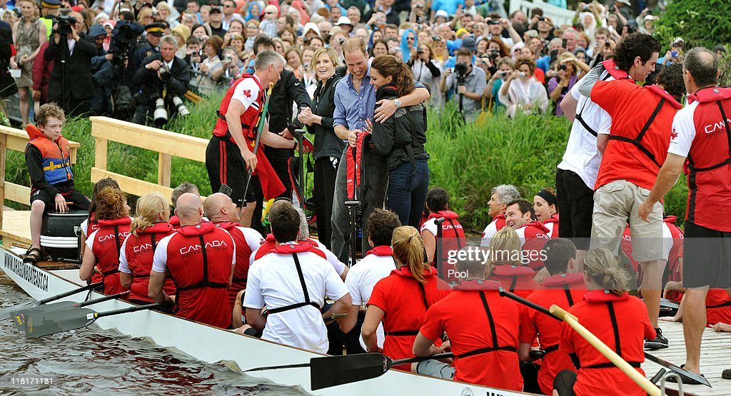 Prince William, Duke of Cambridge hugs his wife Catherine, Duchess of Cambridge after the team he rowed in won a Dragon boat race, in which they competed against each other, across the Dalvay lake on July 4, 2011 in Charlottetown, Canada. The newly married Royal Couple are on the fifth day of their first joint overseas tour. The 12 day visit to North America is taking in some of the more remote areas of the country such as Prince Edward Island, Yellowknife and Calgary. The Royal couple started off their tour by joining millions of Canadians in taking part in Canada Day celebrations which mark Canada's 144th Birthday.