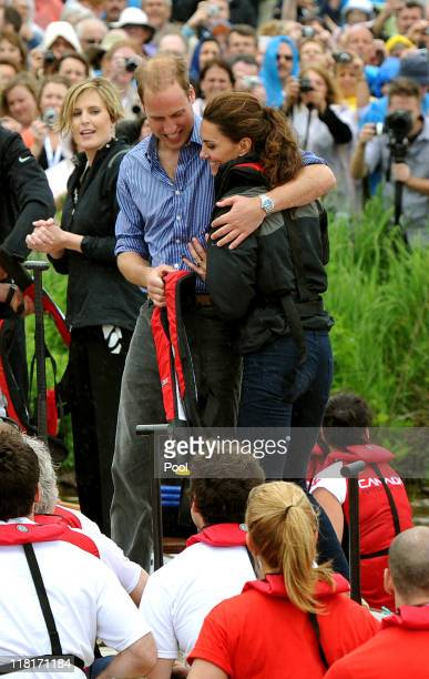Prince William Duke of Cambridge hugs his wife Catherine Duchess of Cambridge after the team he rowed in won a Dragon boat race in which they...