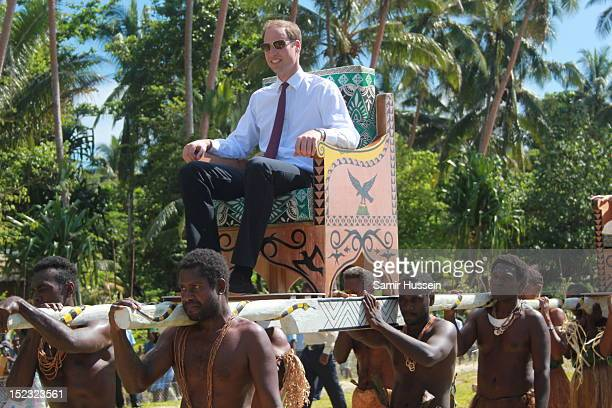 Prince William Duke of Cambridge is carried from the boat from the dock to the plane in Marau on day 8 of a Diamond Jubilee tour of the Far East on...
