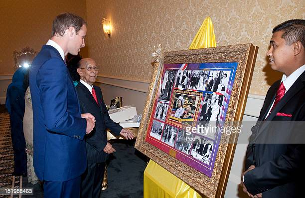 Prince William Duke of Cambridge is given a collection of photographs highlighting the relationship between the Malaysian king and Queen Elizabeth II...