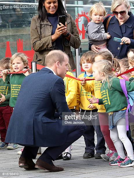 Prince William Duke of Cambridge is greeted by children as he attends the World Mental Health Day celebration with Heads Together at the London Eye...