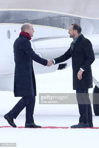 Prince William Duke of Cambridge is greeted by Crown Prince Haakon as he arrives to Oslo Gardermoen Airport on day 3 of their visit to Sweden and...