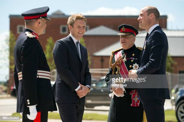 Prince William Duke of Cambridge is greeted by General Timothy GranvilleChapman Hugh Grosvenor the Duke of Westminster and John Peace during the...