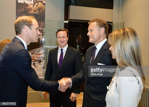Prince William Duke of Cambridge is greeted by Lord and Lady Rothermere as Prime Minister David Cameron looks on during a visit the newly refurbished...