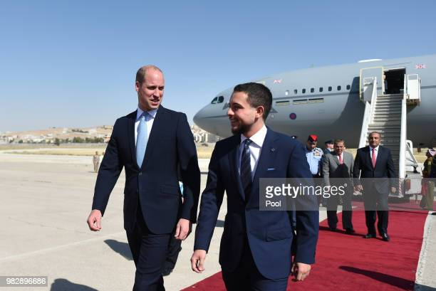 Prince William Duke of Cambridge is greeted by the Crown Prince Hussein of Jordan after arriving at Marka Airport at the start of his Middle East...